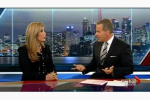 Anchor Leslie Roberts appears with a client of his public relations firm BuzzPR in an undated screen capture from a Global news broadcast. [Photo: Global Television/The Star]