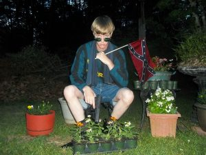 Dylann Roof appears in a photograph taken from the website LastRhodesian.com. (Image: Handout)
