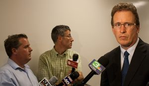 Thomas Burke (right), the attorney representing the Sacramento News & Review, speaks to reporters outside a courtroom at the Sacramento County Courthouse on July 2, 2015. (Photo: Matthew Keys / The Desk)