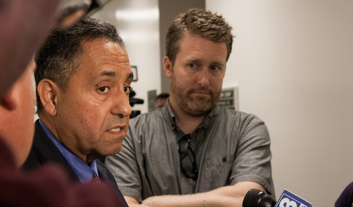 Sacramento News & Review editor Nick Miller (right) looks on as Sacramento City Attorney James Sanchez (left) speaks with reporters following a hearing at the Sacramento County Courthouse on June 2, 2015. (Photo: Matthew Keys / The Desk)