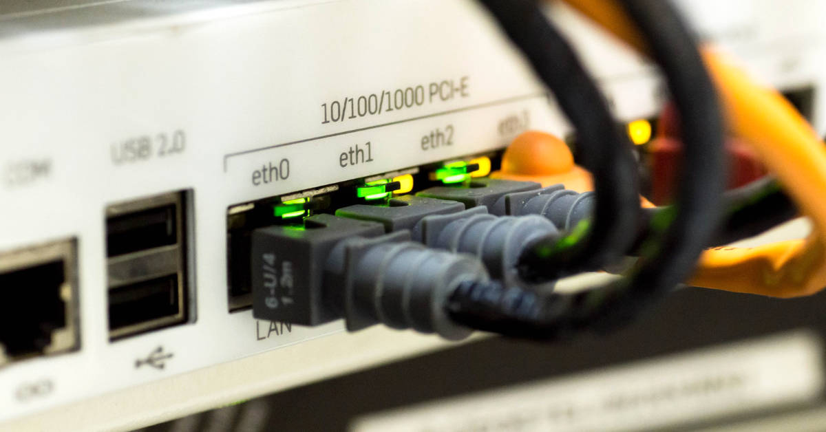 A stock image of an Internet server with Ethernet cables